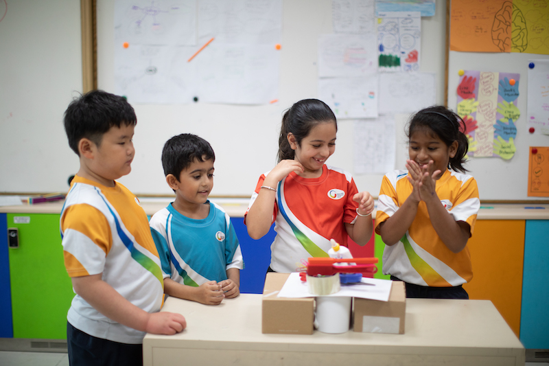 Primary students in the PYP enjoying an independent activity